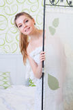 Young girl in the white-green room. Portrait of the smiling young girl royalty free stock images