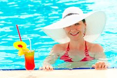 Young girl in a white hat in the swimming pool Royalty Free Stock Image