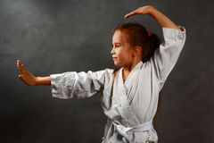 Young girl in a white kimono Stock Photography