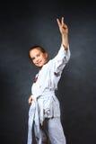 Young girl in a white kimono Stock Image