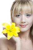 Young girl with white lily flowers Stock Photo