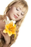 Young girl with white lily flowers Royalty Free Stock Photos