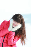 Young girl in white mittens. In the fresh air Stock Photo