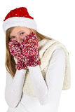 Young girl with white shirt, red winter cap and wooly gloves Royalty Free Stock Image