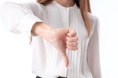 Young girl in white shirt shows a hand gesture bad close-up Royalty Free Stock Photos