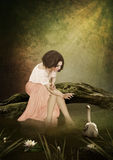 Young girl and white swan Royalty Free Stock Image