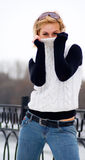Young girl in white sweater Royalty Free Stock Images
