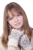 Young girl in white sweater and mittens Royalty Free Stock Image