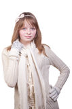 Young girl in white sweater, scarf and mittens Stock Images