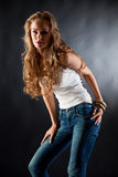 Young girl in white t-shirt and jeans Royalty Free Stock Photo