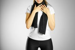 A young girl in a white t-shirt and scarf. A sore throat. Pain i Royalty Free Stock Photos