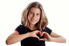 Heart hands meaning I love you over heart by young girl to viewer. Young girl with black shirt isolated on white background in love or frustration poses i love royalty free stock photos