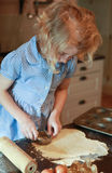 Young girl who is making pastry Stock Images
