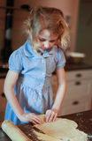 Young girl who is making pastry Royalty Free Stock Photography