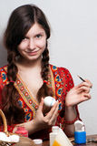 Young girl who is painting an egg for easter Stock Photos