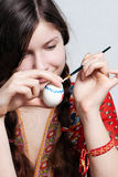 Young girl who is painting an egg for easter Royalty Free Stock Photo