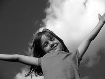 Young girl who wants the world. This black and white portrait captures the fun and excitement of childhood Royalty Free Stock Photo