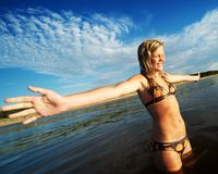 Young girl with wide open hands Stock Photo