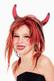 Young Girl in Wig Posing as a Devil Royalty Free Stock Images