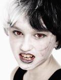 Young Girl in Wig Posing as Vampire Stock Photos