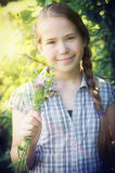 Young girl with wild flowers Stock Image