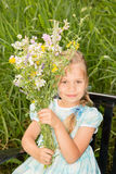 Young Girl with WIldflowers Royalty Free Stock Photography
