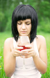 The young girl with a wine glass Stock Images