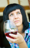 The young girl with a wine glass Stock Photos