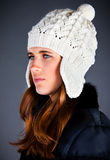 young girl in a winter cap on the dark Stock Photos