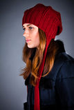 Young girl in a winter cap on the dark Stock Image