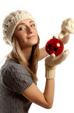 Young girl in winter clothes with christmas ball Royalty Free Stock Image