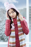 Young girl in winter clothes getting headache Royalty Free Stock Photography