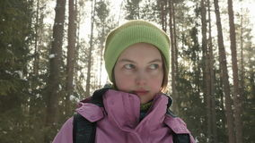 Young girl in the winter forest stock video