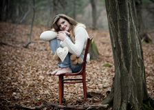 Young girl in winter forest Royalty Free Stock Images