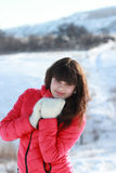 Young girl in a winter forest. Blinnovolosaya young girl in winter forest Royalty Free Stock Photo