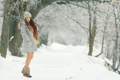 Young girl in winter garden Royalty Free Stock Images