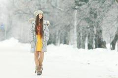 Young girl in winter garden Royalty Free Stock Photos