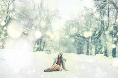 Young girl in winter garden Stock Image