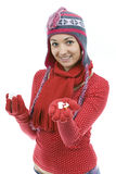 Young girl in winter hat pouring out tablets Royalty Free Stock Photos