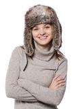 Young girl in a winter hat on white. Young girl in a winter hat over white background stock photo