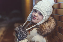 Young girl in winter jacket and knit cap Stock Photography