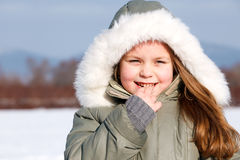 Young girl in winter park Stock Images