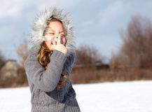 Young girl in winter park Royalty Free Stock Photography