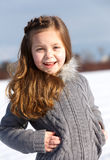 Young girl in winter park Royalty Free Stock Image