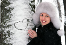 Young girl in winter park Stock Photos