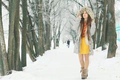 Young girl in winter park Stock Photos