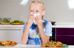 Young girl wiping her mouth Stock Images