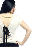 Young Girl With Back Turned Showing Tattoo Royalty Free Stock Photography
