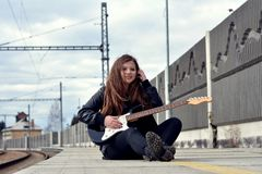 Young Girl With Guitar Royalty Free Stock Photos