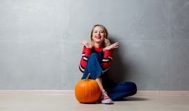 Free Young Girl With Halloween Pumpkin Stock Image - 124531201